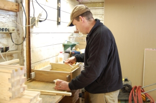 Rogue Beekeeper Josh Cronin assembles the parts using nails, screws and glue.
