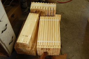 The hive and super boxes come to us in parts. This photo shows a pile of honeycomb frames.