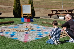 Father and son ponder their next move in Giant Scrabble.