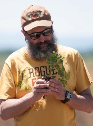 Brewmaster John Maier holding a Yaquina Hop rhizome.