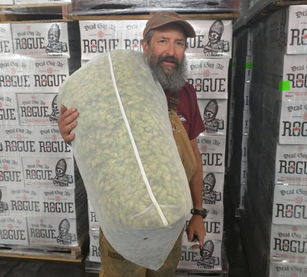 The Brewmaster at his happiest, with a bag of hops ready for brewing.